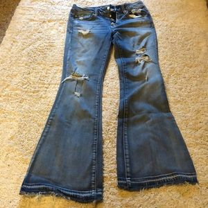 Flare ripped and distressed jeans size 8